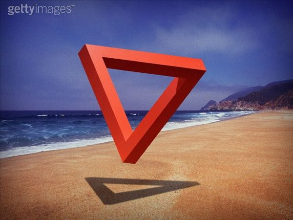 Impossible triangle floating above beach