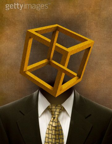 Man's suit with cube in place of head